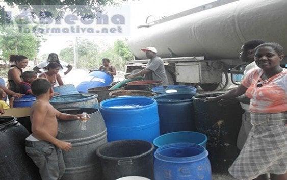 Iglesias colaboran en campaña ahorro agua potable Boca Chica